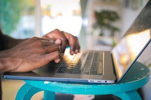 Hands typing in laptop